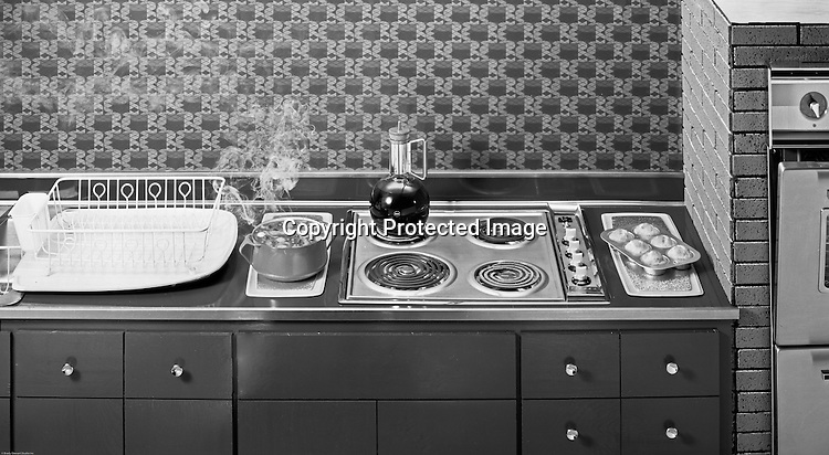 Client: Westinghouse Electric Company<br /> Ad Agency: Ketchum, MacLeod & Grove<br /> Contact: Judy Thomas<br /> Product: Westinghouse Electric Cookbook<br /> Location: Brady Stewart Studio, 725 Liberty Ave, Pittsburgh<br /> <br /> Studio Photography of an all Electric Kitchen for Westinghouse Electric Company 1961. The photograph was used in a brochure highlighting new homes with all-electric appliances