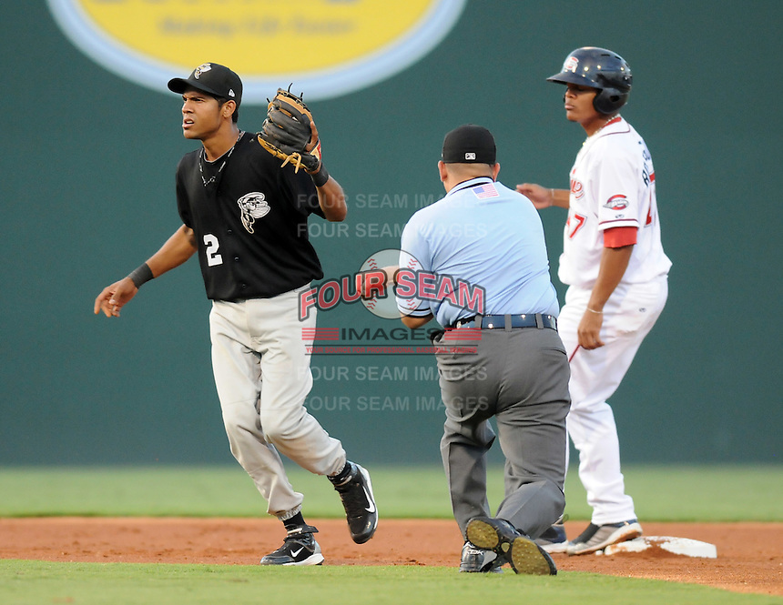Infielder Luis Nieves (2) of the Savannah Sand Gnats gets the out call from the umpire after putting out Reynaldo Rodriguez in Game 1 of the South Atlantic League Southern Division Championship against the Greenville Drive on Sept. 8, 2010, at Fluor Field at the West End in Greenville, S.C. Photo by: Tom Priddy/Four Seam Images