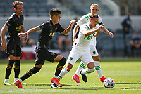 LOS ANGELES, CA - APRIL 17: Tomás Pochettino  #7 of Austin FC moves with the ball during a game between Austin FC and Los Angeles FC at Banc of California Stadium on April 17, 2021 in Los Angeles, California.