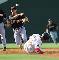 Second baseman Ross Wilson (2) of the Kannapolis Intimidators, Class A affiliate of the Chicago White Sox, turns the first half of a double play in a game against the Greenville Drive on May 27, 2011, at Fluor Field at the West End in Greenville, S.C. Photo by Tom Priddy / Four Seam Images