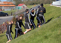 Pictured: Players walk to the training pitch Thursday 25 February<br />Re: Swansea City FC training at Fairwood, near Swansea, Wales, UK, ahead of their game against Tottenham Hotspur.