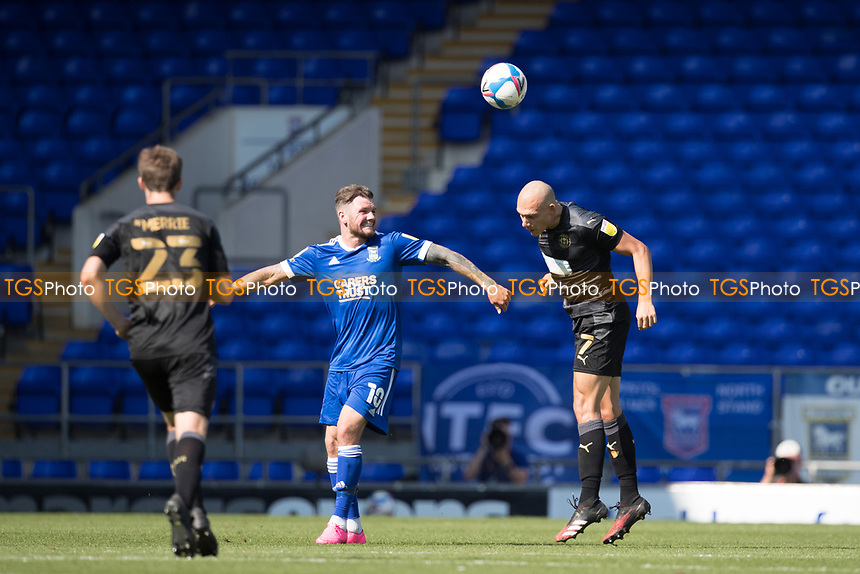 Kai Naismith, Wigan Athletic,  heads clear during Ipswich Town vs Wigan Athletic, Sky Bet EFL League 1 Football at Portman Road on 13th September 2020