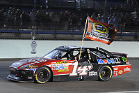 HOMESTEAD, FL - NOVEMBER 20: Tony Stewart, driver of the #14 Office Depot/Mobil 1 Chevrolet, celebrates in Victory Lane after winning the NASCAR Sprint Cup Series Ford 400 and the 2011 Series Championship at Homestead-Miami Speedway. Stewart wins his third NASCAR Championship.  on November 20, 2011 in Homestead, Florida<br /> <br /> <br /> People:  Tony Stewart