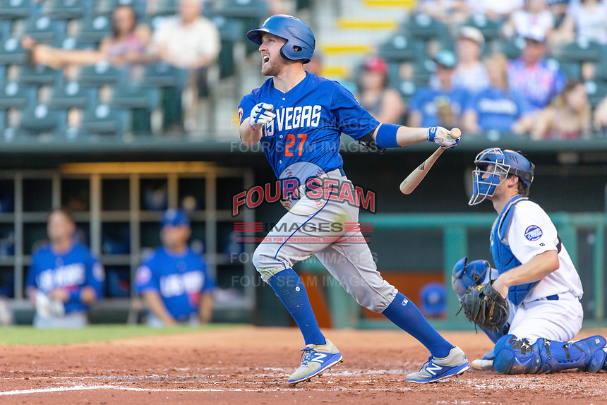 Patrick Kivlehan (27) of the Las Vegas 51s reacts after hitting a ball during a game against the Oklahoma City Dodgers at Chickasaw Bricktown Ballpark on June 17, 2018 in Oklahoma City, Oklahoma. Oklahoma City defeated Las Vegas 5-3  (William Purnell/Four Seam Images)