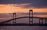 Lights begin to shine on Newport Bridge as the sun set