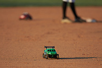 Fans race remote controlled cars around the bases between innings of the game between the Dry Pond Blue Sox and the Mooresville Spinners at Moor Park on July 2, 2020 in Mooresville, NC.  The Spinners defeated the Blue Sox 9-4. (Brian Westerholt/Four Seam Images)