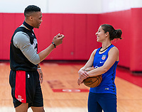 HOUSTON, TX - FEBRUARY 1: Russell Westbrook of the Houston Rockets talks with Carli Lloyd #10 of the United States at Houston Rockets Training Center on February 1, 2020 in Houston, Texas.