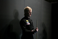 CHINA. Beijing. Australian snooker player Neil Robertson backstage just before going to play at the China Snooker Open. Snooker is a cue sport played on a large table measuring 3.6 metres x 1.8 metres. Originating in India in the late 19th Century where it was invented by British Army officers, the game has been a mainstay in British sport over the past few decades. Recently however, popularity of the sport has declined as the sport struggles to compete with other popular sports. The sport is however flourishing in countries such as China, where it is now the second most popular sport, behind Basketball. In a country where the  players are treated like movie-stars, China may be the great hope for the sports recovery. 2009