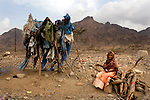 A girl sits next to the main road to the South in Yemen, Nov. 30, 2009. A raging conflict with Houthi rebels in Yemen's north and clashes with separatists in the South continue to erode stability in the Arabian Peninsula's poorest state, where half of the population lives in abject poverty.