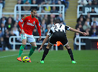 Saturday 17 November 2012<br /> Pictured L-R: Itay Shechter of Swansea against Steven Taylor of Newcastle <br /> Re: Barclay's Premier League, Newcastle United v Swansea City FC at St James' Park, Newcastle Upon Tyne, UK.