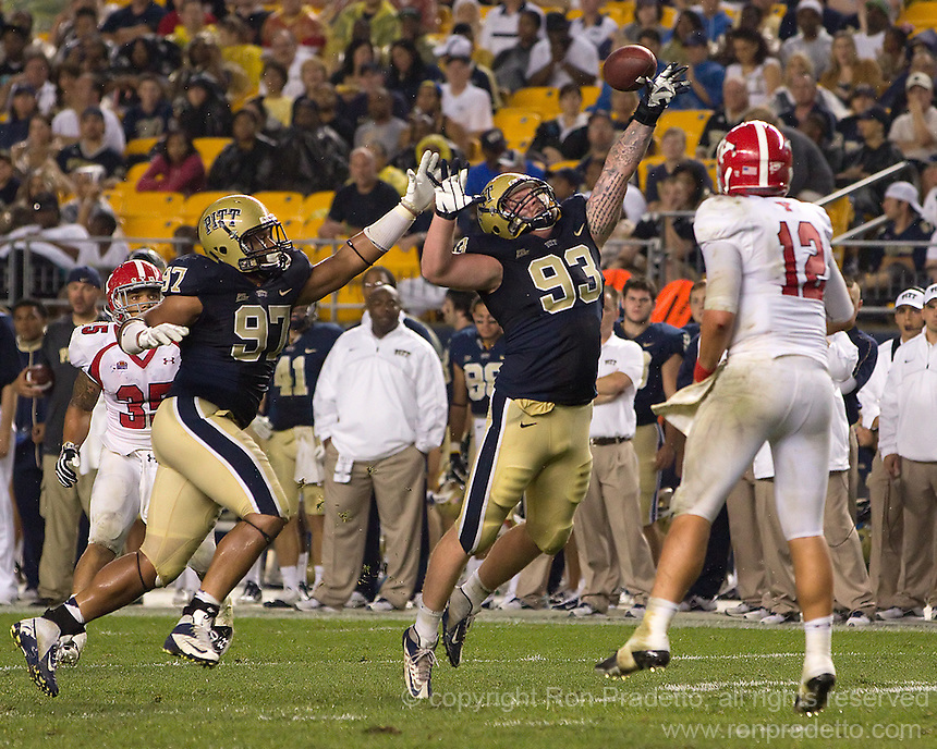 Pitt defensive linemen Aaron Donald (97) and Bryan Murphy (93) try in vain to knock down a pass thrown by Youngstown State quarterback Kurt Hess (12). The Youngstown St. Penguins defeated the Pittsburgh Panthers 31-17 on Saturday, September 1, 2012 at Heinz Field in Pittsburgh, PA.