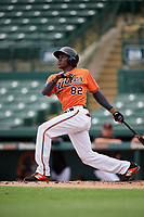 Baltimore Orioles Jean Carlos Encarnacion (82) follows through on a swing during a Florida Instructional League game against the Boston Red Sox on October 8, 2018 at the Ed Smith Stadium in Sarasota, Florida.  (Mike Janes/Four Seam Images)