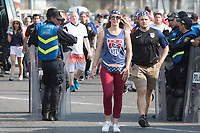 MEXICO CITY, MEXICO - June 11, 2017:  USA fans walk through a police line to attend the World Cup Qualifier match against Mexico at Azteca Stadium.