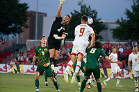 COLLEGE PARK, MD - SEPTEMBER 3: Maryland University forward Justin Gielen (9)heads away from George Mason University goalkeeper Jackson Lee (1) during a game between George Mason University and University of Maryland at Ludwig Field on September 3, 2021 in College Park, Maryland.