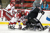 Dan Ford (Harvard - 5), Danny Biega (Harvard - 9), ?, Derek Bacon (Bentley - 22) - The Harvard University Crimson defeated the visiting Bentley University Falcons 5-0 on Saturday, October 27, 2012, at Bright Hockey Center in Boston, Massachusetts.
