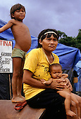 Roraima, Brazil. Displaced Yanomami woman and her children, driven out of her home by garimpeiro gold prospectors.