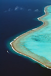 Aerial of a boat cruising near the reef, Bora Bora, French Polynesia