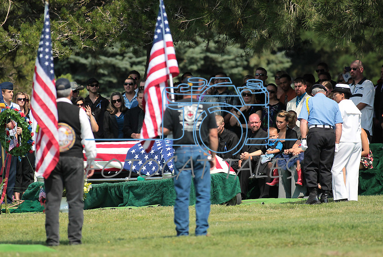 An estimated 500 people attended a memorial service for Colorado shooting victim Jonathan Blunk, in Reno, Nev. on Friday morning, Aug. 3, 2012. Blunk's wife Chantel and their son Maximus, 2, are at right. (AP Photo/Cathleen Allison)