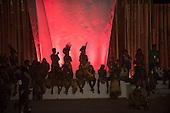 Indigenous participants relax in front of the Sacred Flame during the International Indigenous Games, in the city of Palmas, Tocantins State, Brazil. Photo © Sue Cunningham, pictures@scphotographic.com 24th October 2015