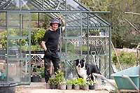 BNPS.co.uk (01202) 558833. <br /> Pic: CorinMesser/BNPS<br /> <br /> Carey Secret Garden. <br /> <br /> Head gardener Paul Scriven with dog Finn.<br /> <br /> The new owners of a historic country estate have discovered an overgrown secret garden that had lain untouched and forgotten for more than 40 years.<br /> Simon Constantine was astounded when he and his children went off exploring the grounds of Carey House near Wareham, Dorset, and found the 'lost' walled garden behind a padlocked gate.<br /> The 3.5 acre plot was built 140 years ago and would have at one stage served both the estate and the wider community with fresh fruit, vegetables and cut flowers back in the day.