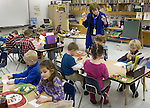 SOUTHBURY, CT. 14 January 2013-011413SV03- Kindergarten teacher Marion Bouffard works on a spelling lesson with students at Gainfield Elementary School in Southbury Monday. The Region 15 Board of Education will vote on both a full-day kindergarten and redistricting plan to take effect in the 2013-14 school year.<br />Steven Valenti Republican-American
