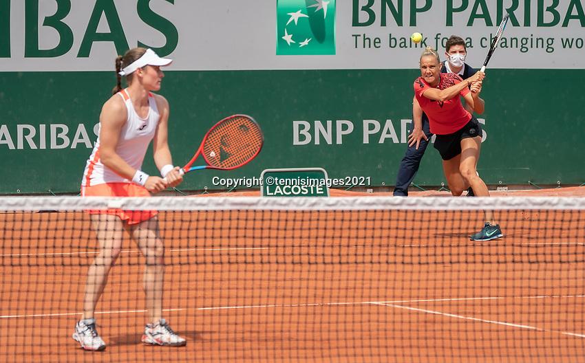 Paris, France, 2 june 2021, Tennis, French Open, Roland Garros, First round womans doubles match: Arantxa Rus (NED) (R) and  Tamara Zidansek<br /> Photo: tennisimages.com