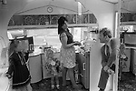 Interior of gypsy caravan, kitchen area there is no running water as it is considered unlucky. Mother two daughter and father. The Derby Day horse race, Epsom Down England. 1974