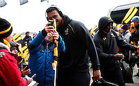 Photo: Richard Lane/Richard Lane Photography. Wasps v Newcastle Falcons. Aviva Premiership. 06/02/2016. Wasps' Nathan Hughes poses for photographs with supporters as the team arrive at the stadium.