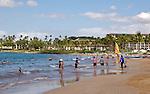 Vacationers enjoy the sun and waves off Wailea on the island of Maui.