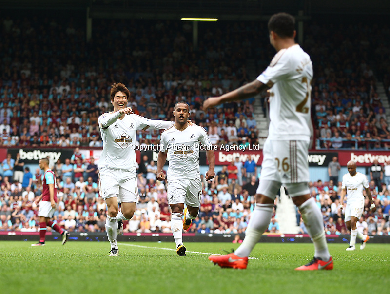 Wayne Routledge of Swansea celebrates scoring the opening goal   during the Barclays Premier League match between West Ham United and Swansea City  played at Boleyn Ground , London on 7th May 2016