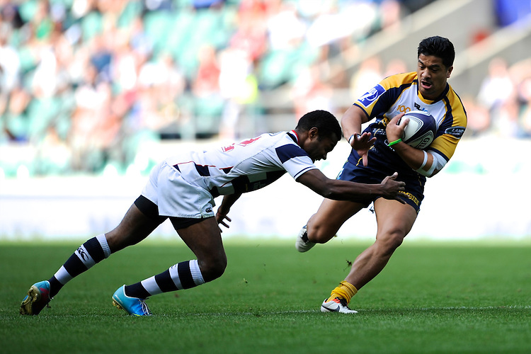 Rodney Iona of the Brumbies looks to hand off Varasiko Duisokosoko of Auckland during the World Club 7s at Twickenham on Sunday 18th August 2013 (Photo by Rob Munro)