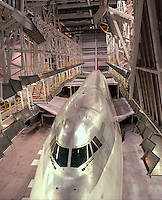 The front view of a 747 airplane in a hangar.