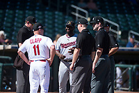 Salt River Rafters manager Tommy Watkins (8) meets with Surprise Saguaros manager Stubby Clapp (11) and umpires Alex Tosi, Junior Valentine, John Bacon, and Jeremy Riggs before an Arizona Fall League game on October 9, 2018 at Surprise Stadium in Surprise, Arizona. The Rafters defeated the Saguaros 10-8. (Zachary Lucy/Four Seam Images)