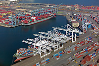 aerial photograph of the containerships docked at the loading cranes at the Port of Long Beach, Los Angeles County, California