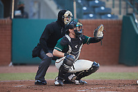 Greensboro Grasshoppers catcher Grant Koch (23) sets a target as home plate umpire Adam Pierce looks on during the game against the Hickory Crawdads at First National Bank Field on May 6, 2021 in Greensboro, North Carolina. (Brian Westerholt/Four Seam Images)