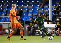 LAKE BUENA VISTA, FL - JULY 18: Yimmi Chará #23 of the Portland Timbers carries the ball while defended by Aljaz Struna #5 of the Houston Dynamo during a game between Houston Dynamo and Portland Timbers at ESPN Wide World of Sports on July 18, 2020 in Lake Buena Vista, Florida.