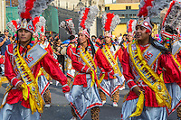 Lima, Peru.  Young Peruvian Men Marching in an Andean Cultural Parade, Plaza de Armas.