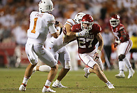 Arkansas linebacker Hayden Henry (27) rushes towards exas quarterback Hudson Card (1), Saturday, September 11, 2021 during the third quarter of a football game at Reynolds Razorback Stadium in Fayetteville. Check out nwaonline.com/210912Daily/ for today's photo gallery. <br /> (NWA Democrat-Gazette/Charlie Kaijo)