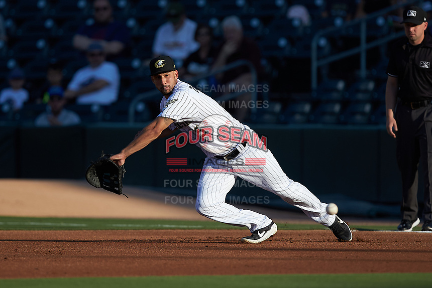 Charlotte Knights first baseman Seby Zavala (5) makes a diving attempt to stop a ground ball during the game against the Buffalo Bisons at BB&T BallPark on July 24, 2019 in Charlotte, North Carolina. The Bisons defeated the Knights 8-4. (Brian Westerholt/Four Seam Images)