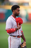 Syracuse Chiefs left fielder Brian Goodwin (15) during the national anthem before a game against the Rochester Red Wings on July 1, 2016 at Frontier Field in Rochester, New York.  Rochester defeated Syracuse 5-3.  (Mike Janes/Four Seam Images)