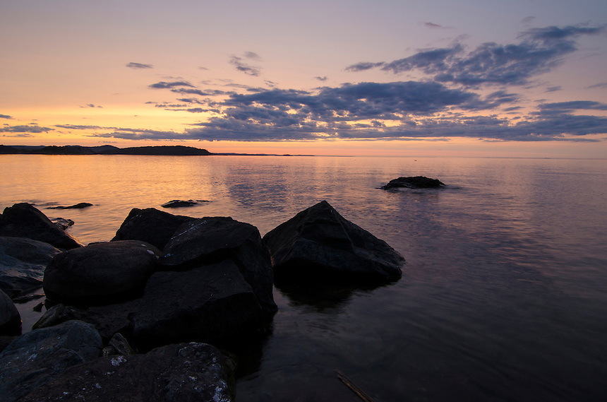 Summer Lake Superior sunset viewed from Presque Isle park. Marquette, MI