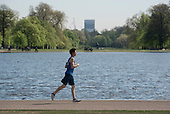 Young man jogging, Kensington Gardens, London.