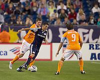 New England Revolution midfielder Marko Perovic (29) dribbles as Houston Dynamo defender Bobby Boswell (32) pressures. The New England Revolution defeated Houston Dynamo, 1-0, at Gillette Stadium on August 14, 2010.