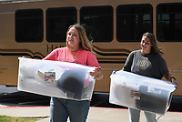 Katelyn Fehr (from left) and Peri Reagan carry personal care items, Monday, September 13, 2021 at Harding University in Rogers. Members of the Harding student body paid for and collected over $10,000 worth of personal care items for incoming refugees. The items will go to Canopy NWA who will disperse the items. Check out nwaonline.com/210914Daily/ for today's photo gallery. <br /> (NWA Democrat-Gazette/Charlie Kaijo)