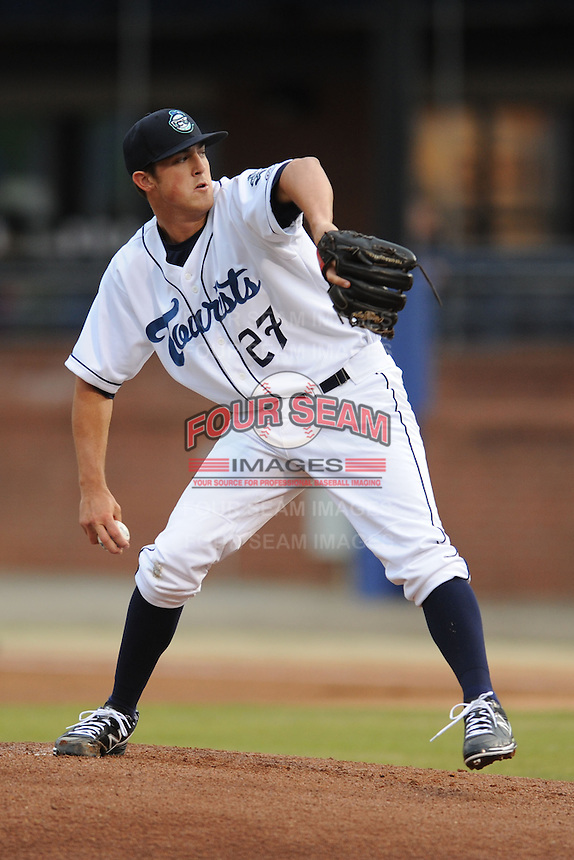 Asheville Tourists starting pitcher Zach Jemiola #27 delivers a pitch during a game against the Delmarva Shorebirds at McCormick Field on April 4, 2014 in Asheville, North Carolina. The Shorebirds defeated the Tourists 7-2. (Tony Farlow/Four Seam Images)