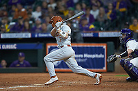 Douglas Hodo III (7) of the Texas Longhorns follows through on his swing against the LSU Tigers in game three of the 2020 Shriners Hospitals for Children College Classic at Minute Maid Park on February 28, 2020 in Houston, Texas. The Tigers defeated the Longhorns 4-3. (Brian Westerholt/Four Seam Images)