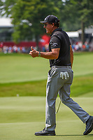 """4th July 2021, Detroit, MI, USA;  Phil Mickelson (USA) gives a thumbs up to the crowd gathered around the green on 18 as they chant, """"Come back, Phil!"""" during the Rocket Mortgage Classic Rd4 at Detroit Golf Club on July 4,"""