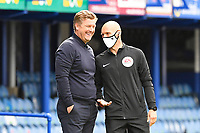 Oxford United Manager Karl Robinson left jokes with the fourth official during Portsmouth vs Oxford United, Sky Bet EFL League 1 Play-Off Semi-Final Football at Fratton Park on 3rd July 2020