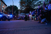 Demonstrators kneel and link arms in front of a police vehicle attempting to disperse a protest near the White House in Washington, D.C., U.S., on Monday, June 1, 2020, following the death of an unarmed black man at the hands of Minnesota police on May 25, 2020.  More than 200 active duty military police were deployed to Washington D.C. following three days of protests.  Credit: Stefani Reynolds / CNP/AdMedia