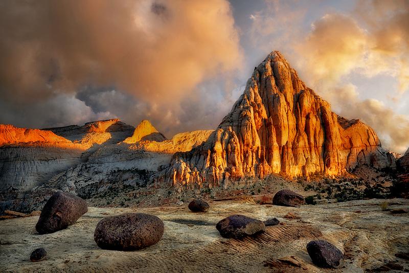 Pectol's Pyramid with glacial erratic boulders at sunset. Capitol Reef National Park, Utah